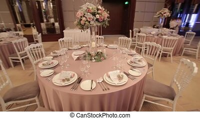 Beautiful table setting with a bouquet of flowers