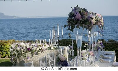 Beautiful table setting with crockery and flowers for a...
