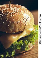 beautiful Tasty and appetizing hamburger cheeseburger on wooden background