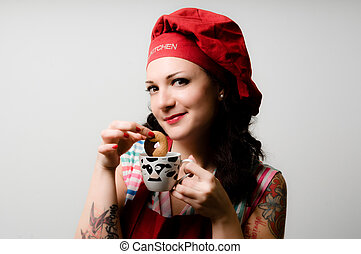 beautiful tattooed pinup cook girl with biscuit