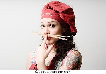 beautiful tattooed pinup cook girl with spaghetti