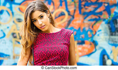 Beautiful teen ager, before a colorful mural - Portrait of a...