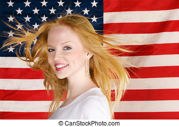 Beautiful teen girl against american flag