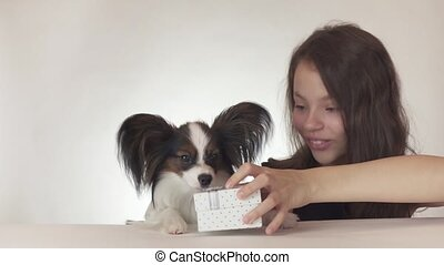 Beautiful teen girl gives a delicious gift to a dog...
