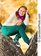 Beautiful teen girl having fun outdoors