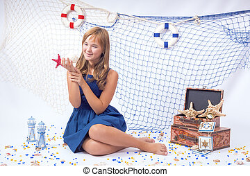 Beautiful teen girl listening sea shell with fishing net