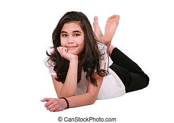 Beautiful teen girl lying on floor relaxing