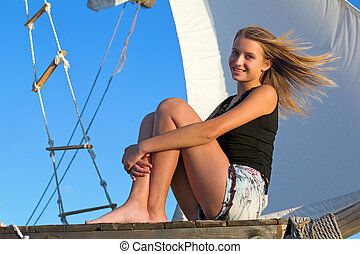 teen girl sitting at stern of the ship