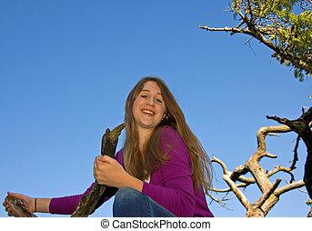 Beautiful Teen Girl Smiling in Tree