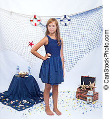 Beautiful teen girl standing with fishnet in sea background