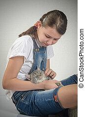 beautiful teen girl with a kitten