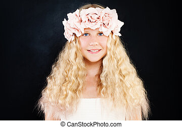 Beautiful Teen Girl with Blonde Curly Hair and Flowers on Dark Background