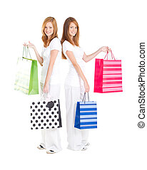 teen girls carrying shopping bag