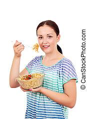 beautiful teenage girl eating spaghetti