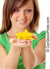 Beautiful teenage girl holding sunflower