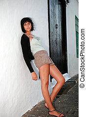 Beautiful teenage girl on street in the evening