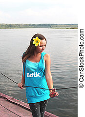 beautiful teenage girl on the bank of the river