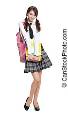 Beautiful teenage schoolgirl with books and backpack full...