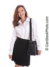 Beautiful teenage student girl in school uniform