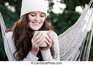 Beautiful teenager drinking coffee
