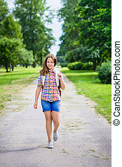 Beautiful teenager girl in casual clothes going to school