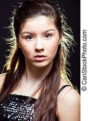 beautiful  teenager girl with long dark hair on black