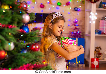 Beautiful ten-year-old girl received a gift from Santa Claus