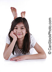 Beautiful ten year old girl relaxing on floor