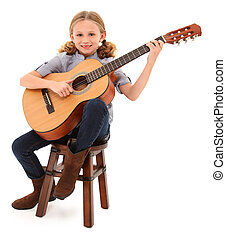Beautiful ten year old with acoustic guitar over white with...