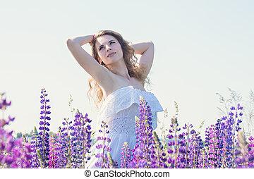 Beautiful tender woman - Beautiful young woman in a field...