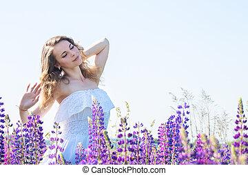 Beautiful tender woman in a field