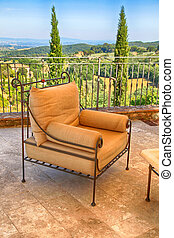 Beautiful terrace with armchair, Tuscany, Italy