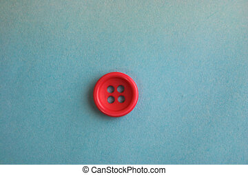 Beautiful texture with a round button for sewing, needlework. Copy space. Flat lay. Blue background