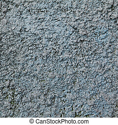 Beautiful textured blue wall with stains and spots