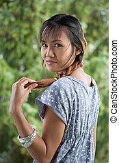 Beautiful Thai woman in nature