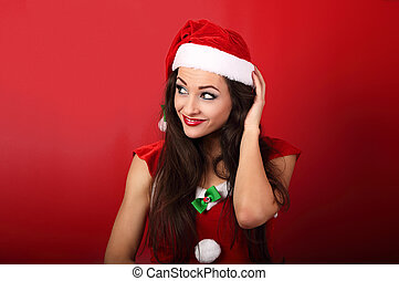 Beautiful thinking grimacing woman in santa claus christmas costume scratching the head on red background with empty copy space