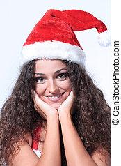 Beautiful thinking woman in santa claus christmas costume -...