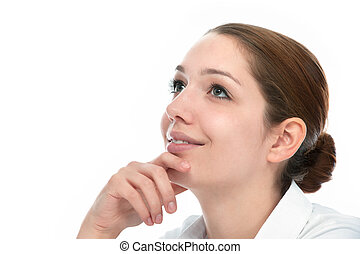 Beautiful thoughtful woman looking up