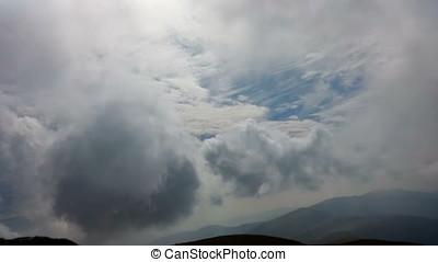 Beautiful timelapse clouds over mountain ridge