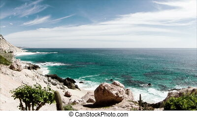 beautiful timelapse shot in los cabo, baja california sur mexico where the desert reaches right down to the pacific ocean. there is an amazing quality of light around this area