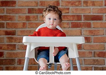 toddler baby boy sitting in armchair