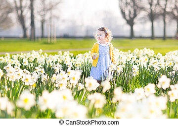 Beautiful toddler girl in field