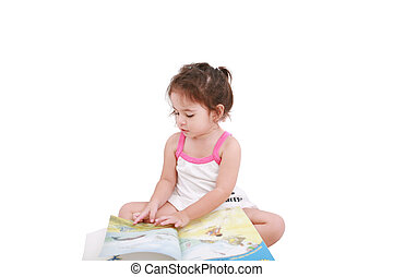 Beautiful toddler girl reading a book