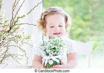 Beautiful toddler girl with flowers