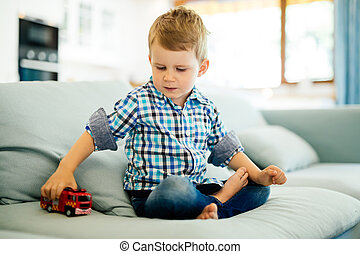 Beautiful toddler playing with his toy