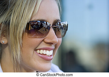 Beautiful Toothy Smile - A beautiful young blond woman...