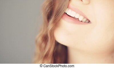 Beautiful toothy smile of young woman with perfect healthy ...