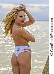 Beautiful Topless Blonde Model Enjoying The Caribbean Environment