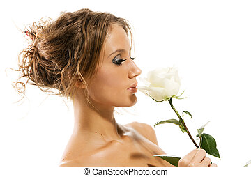 Beautiful topless woman with a white rose