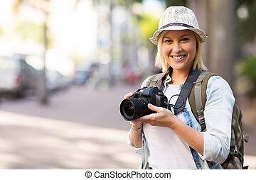 tourist holding camera